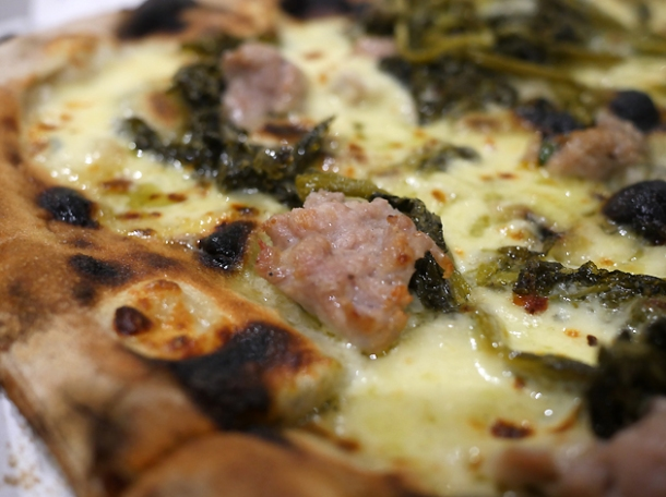 salsicca and friarielli pizza from rust bucket at street feast woolwich public market