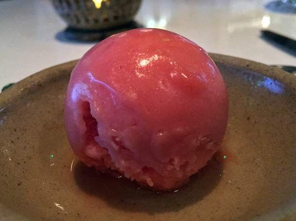 illustrative photo of the blood orange sorbet mid-tasting menu palate cleanser at Kanishka