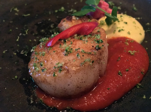 illustrative photo of the scallop with cauliflower puree from the tasting menu at Kanishka