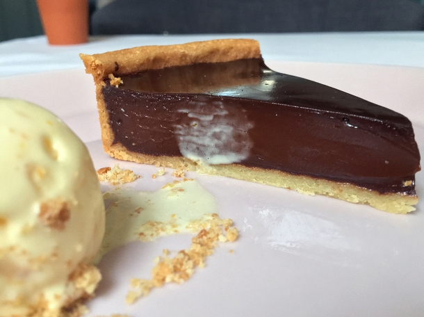 illustrative photo of the dark chocolate tart with orange ice cream at Myrtle