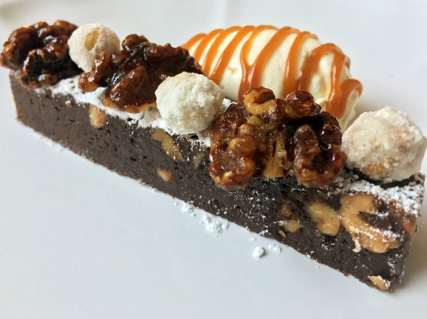 illustrative photo of the chocolate and nut brownie with butterscotch sauce at Siren at The Goring Hotel
