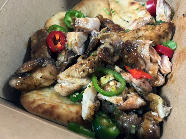 illustrative photo of the jerk chicken naan from Juici Jerk at Mercato Metropolitano Southwark