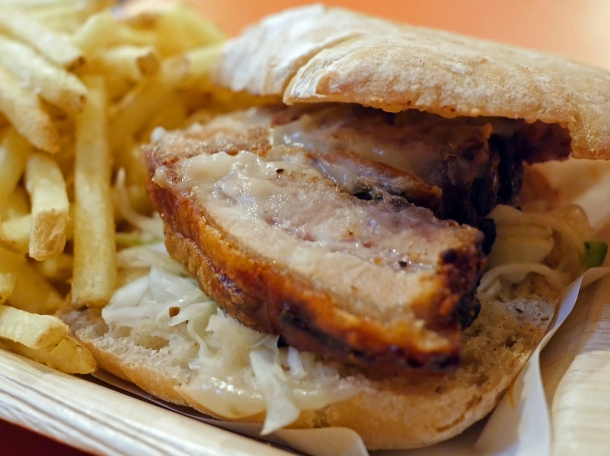 illustrative photo of the roast pork ciabatta with chips from Roast To Go at Mercato Metropolitano Southwark