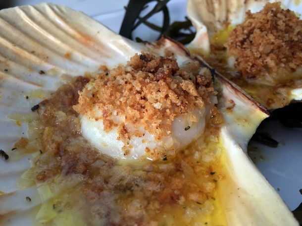 illustrative photo of the scallops baked in rosemary and orange butter at Siren at The Goring Hotel