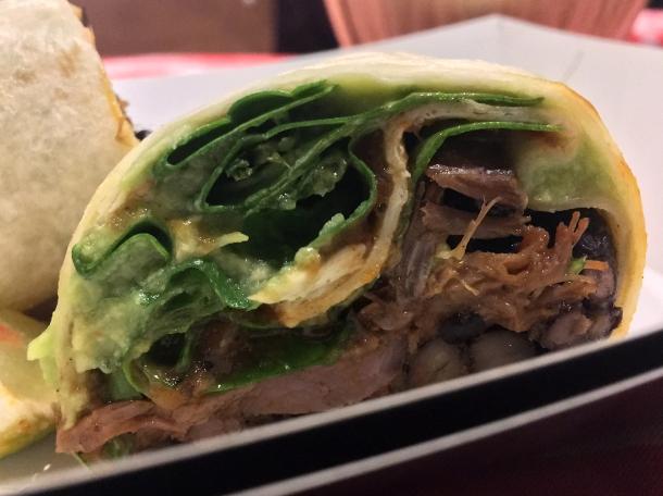 illustrative photo of the al pastor pork burrito from Breddos at Flat Iron Square