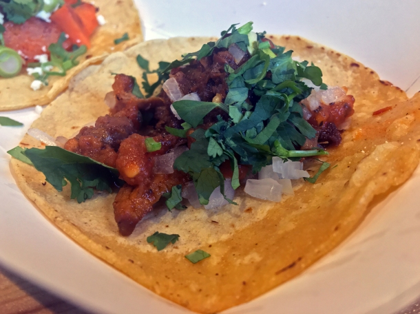 illustrative photo of the al pastor pork tacos from Breddos at Flat Iron Square