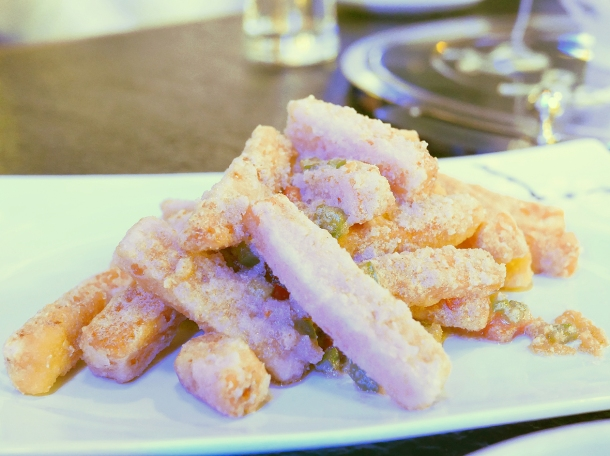 illustrative photo of the sweet potato fries with salted egg yolk at Seveni