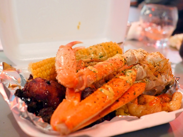 illustrative photo of the snow crab legs and jerk chicken at Trap Kitchen Balham
