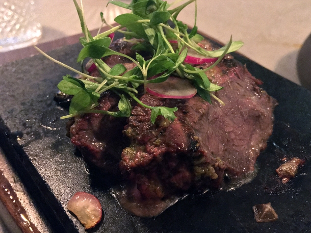illustrative photo of the lava stone steak at Madera Treehouse