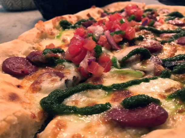 illustrative photo of the wagyu pizza at Madera Treehouse