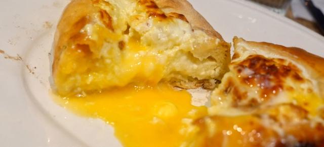 illustrative photo of the khachapuri megruli cheese egg flatbread at The Georgian