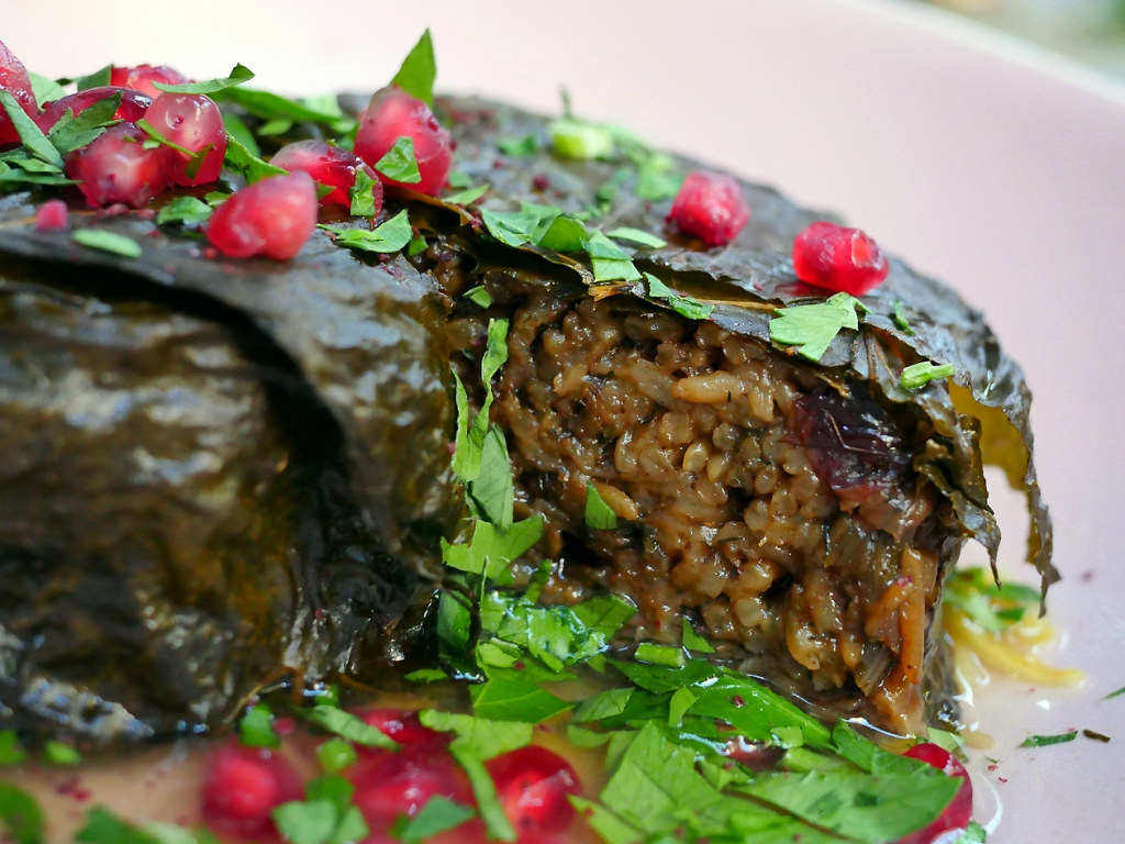 illustrative photo of the grape leaf rice pie at Bala Baya